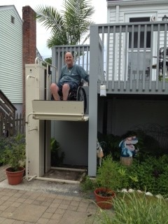 Vertical Home Lift PL-50 being used to access a porch