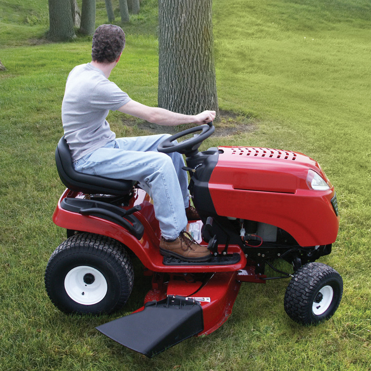 Easy Rider Lawn Mower Steering Knob being used on a red riding lawnmower