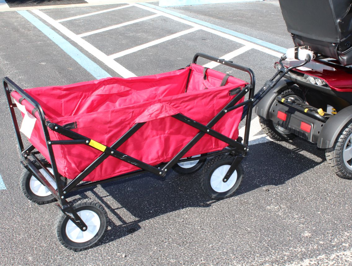 Scooter pulliing wagon using the Haul-N-Go